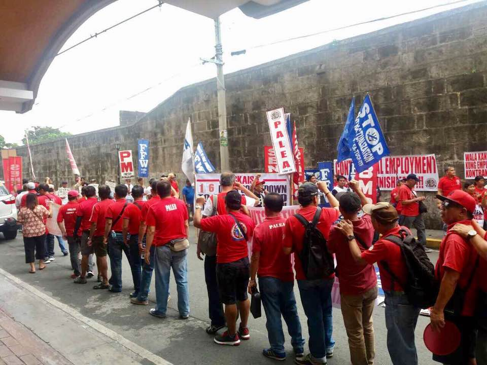 NAGKAISA infront of DOLE HQ in Manila while Labor Secretary Silvestre Bello announcing the DO174
