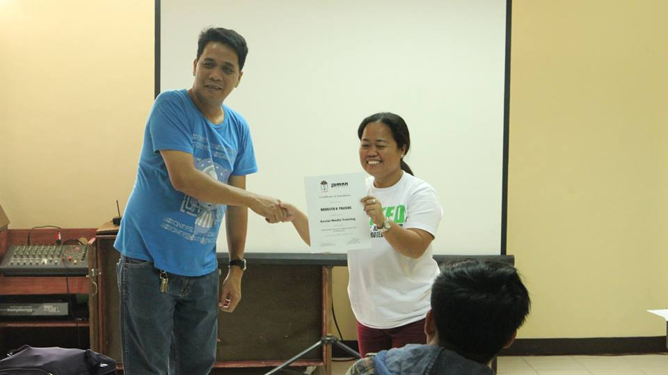 Novelita Palisoc, President at Murphy Domestic Workers of the Philippines Chapter receiving her Certificate after completing the 3 days Social Media Training conducted by LEARN. With her is John Mape, Education officer of LEARN